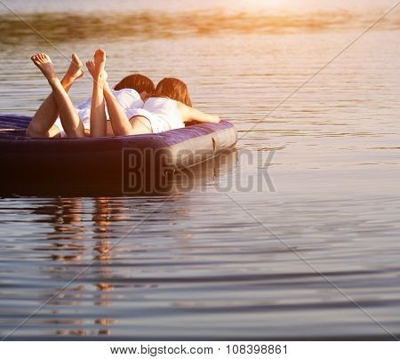 Young couple on the swimming mattress