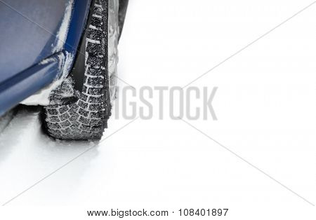 Close-up Image of Winter Car Tire on the Snowy Road with Space for Your Text. Drive Safe Concept
