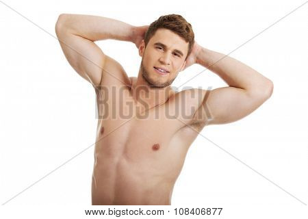Handsome muscular man showing his well build chest.