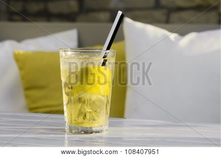 Yellow mojito cocktail on table in low glass