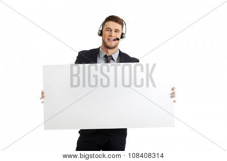 Handsome call center woman holding empty banner.