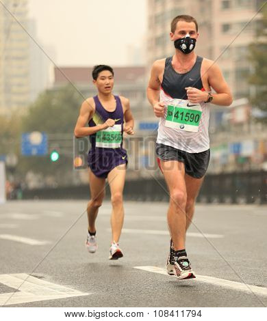 arathon runners running on city road