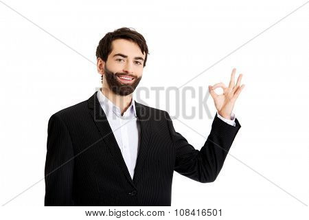 Happy smiling businessman showing perfect sign.