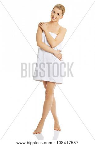 Beautiful happy spa woman wrapped in towel.