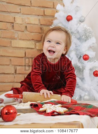 Happy Little Baby Girl With Big Blue Eyes In Red Dress Making Cookies For Christmas