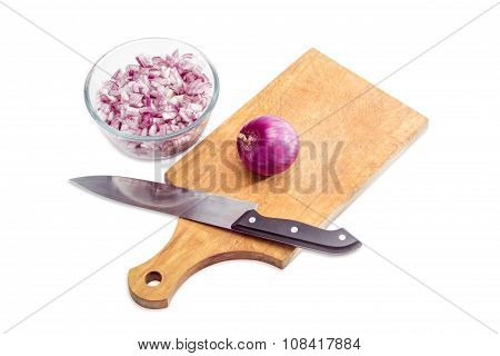 Chopped Red Onion, Bulb Onion And Knife On Cutting Board