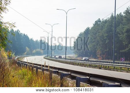 Part Of The Motorway With Forest On Both Sides Autumn