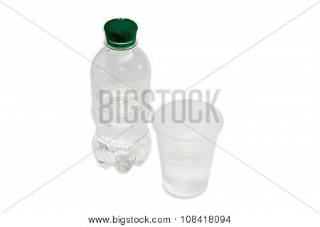 Water Bottle And Plastic Cup With Water
