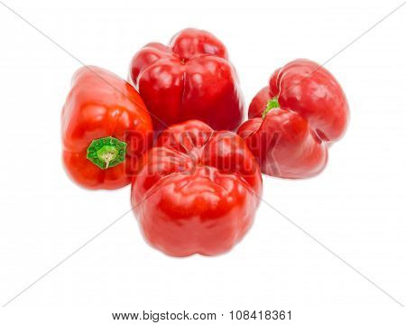Four Bell Peppers On A Light Background