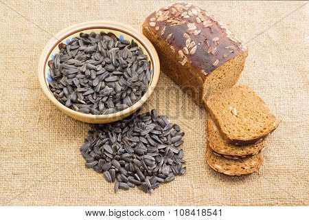 Brown Bread And Sunflower Seeds On The Sackcloth