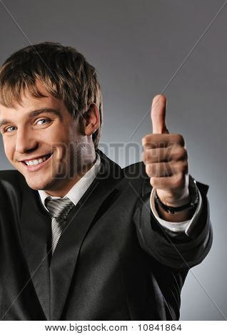 Happy businessman showing his thumbs up with smile