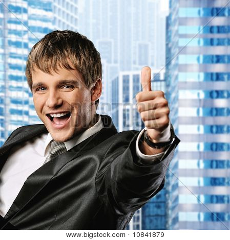 Happy businessman showing his thumb up with smile