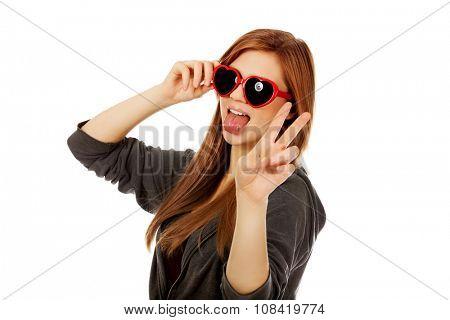 Young teenage woman wearing sunglasses.