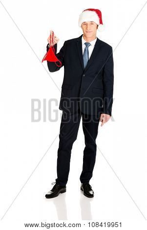 Santa businessman with female thongs on finger.