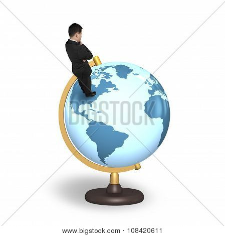 Thinking Businessman Standing On Terrestrial Globe