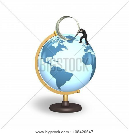 Businessman Pushing Roll Of Dollar Bills On Terrestrial Globe