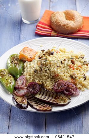Bulgur pilaf with grilled eggplant, pepper, and onion