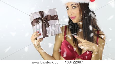 sexy woman holding a christmas present