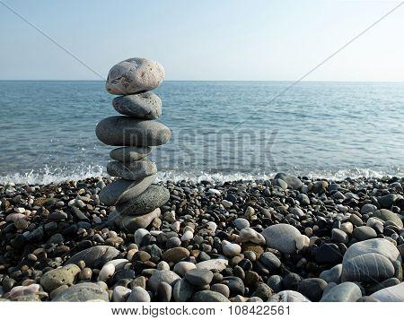 Black sea, sun and pebbles