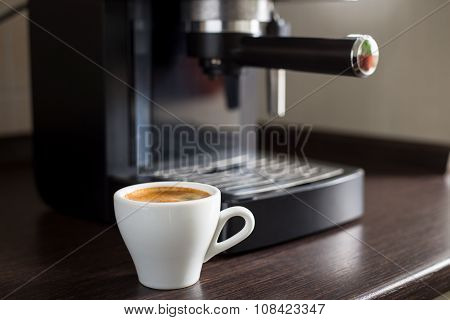 White Ceramic Cup Of Espresso With Coffee Machine