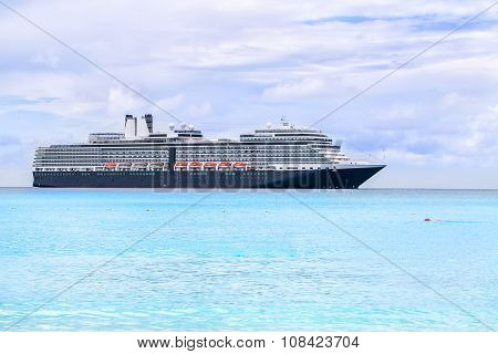 Cruise Ship On A Light Blue Sea At Half Moon Cay In The Bahamas.