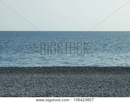 Landscape of sea and pebble beach