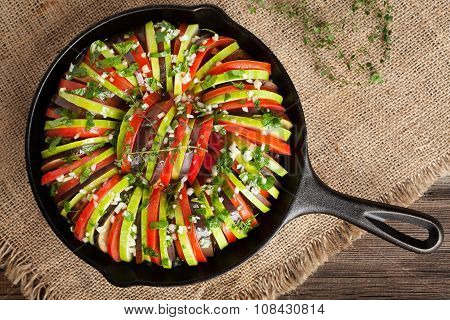 Traditional raw vegetable ratatouille in cast iron frying pan preparation recipe heathy organic vege