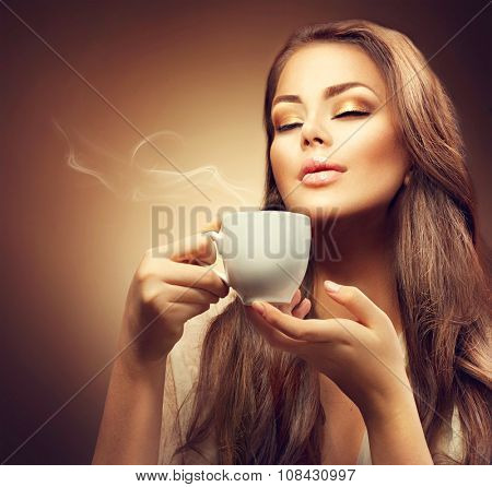Beautiful Young Woman Drinking Coffee. Beauty Model Girl enjoying hot espresso. Lady holding Cup of coffee over brown background with space for your text