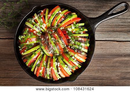 Traditional raw vegetable ratatouille in cast iron pan preparation recipe homemade healthy vegetaria