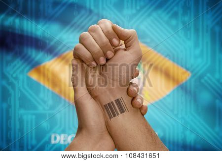 Barcode Id Number On Wrist Of Dark Skinned Person And Usa States Flags On Background - Delaware