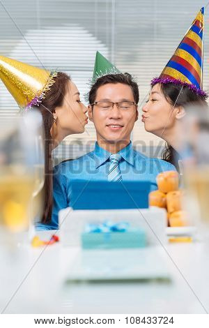 Kissing birthday man