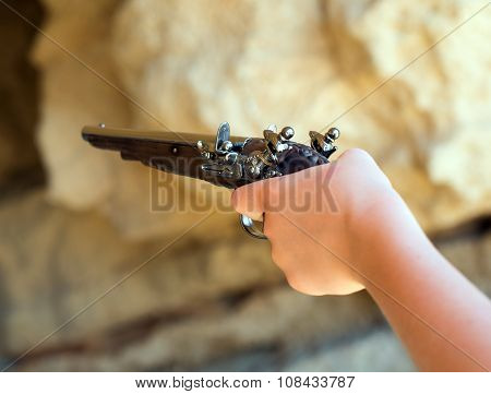 Child Hand With Old Musket Gun Aiming.