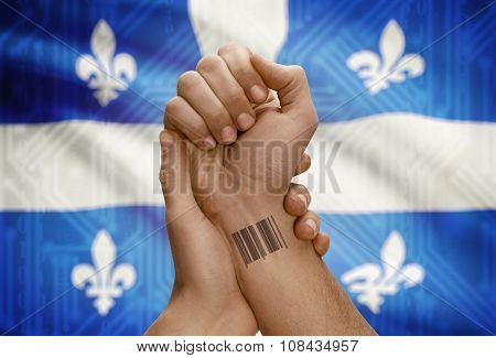Barcode Id Number On Wrist Of Dark Skin Person And Canadian Province Flag On Background - Quebec