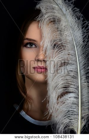 Face With Feather