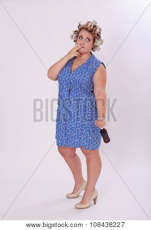 Woman With Hair Curler Smoking A Cigarette