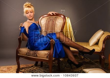 Aristocratic Lady In A Dark Blue Dress