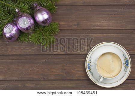 Cup of coffee and Christmas. Christmas decorations on a wooden board.