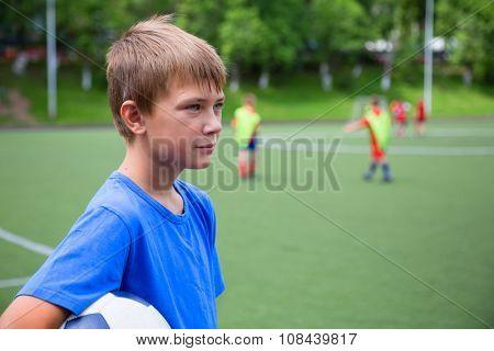 Children playing football at the stadium