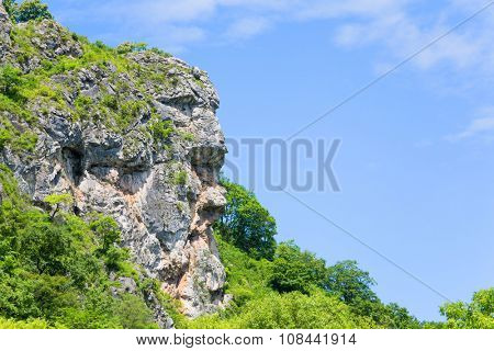 Natural cliff in the shape of a human head allocated to the mountain range. Far East, Russia.