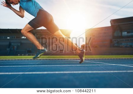 Runner Practicing In Athletics Stadium