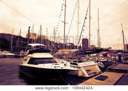 Sailing and motor yachts anchored at Vladivostok, Russia. Image retro vintage filter effect.