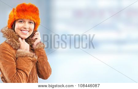 Young woman wearing winter coat over banner background.