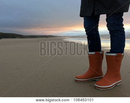 Orange Wellington Boots on the Beach