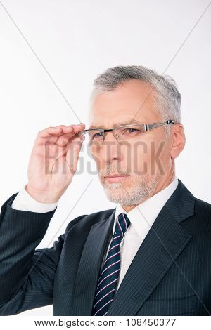 Handsome Intelligent Old Man In Business Suit Holding Glasses