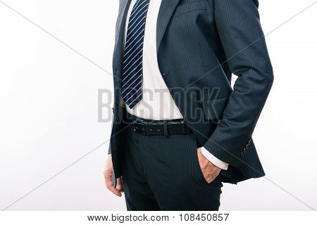 Closeup Photo Of A Businessman Holding Hand In A Pocket