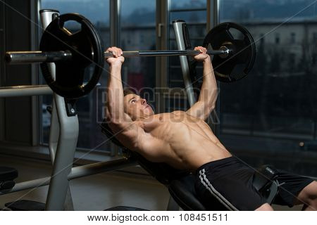 Young Man Doing Bench Press Exercise For Chest