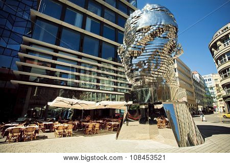Metal Monument By Sculptor David Cerny In Urban Area Of Modern City