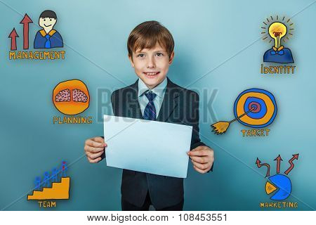 Teen boy businessman is smiling and holding a blank sheet of pap