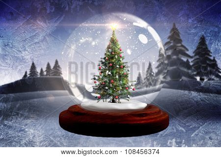Digitally generated Christmas tree in snow globe