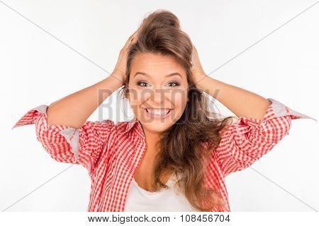 Excited Happy Young Woman Holding Her Head